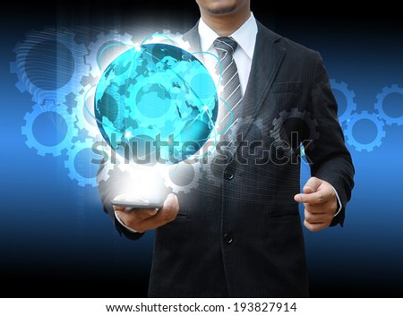 businessman holding smartphone world technology social media and cog gear - stock photo