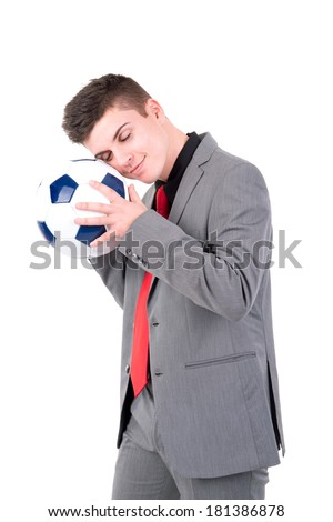 Businessman holding soccer ball isolated in white - stock photo