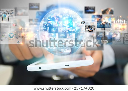 Businessman holding social media concept.