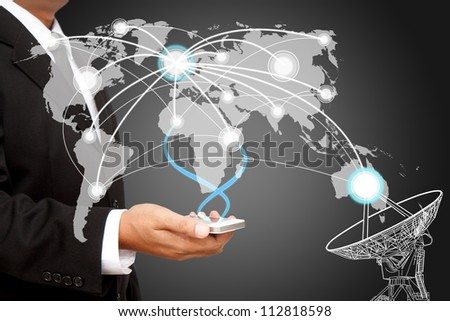 Businessman holding  social network structure - stock photo