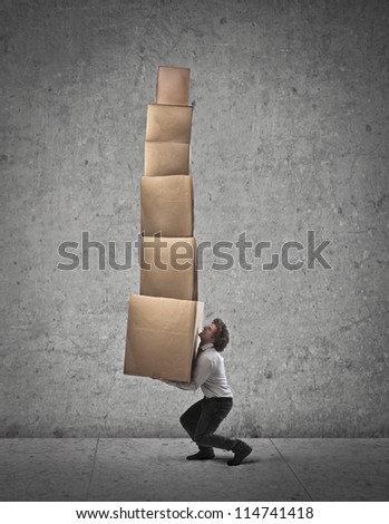 Businessman holding some boxes - stock photo