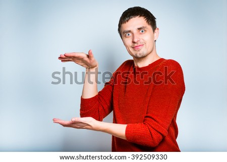 Businessman holding something in his hands, isolated on a gray background
