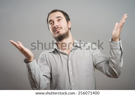 Businessman holding something in his hands on a gray background - stock photo