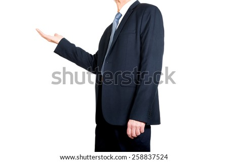 Businessman holding something invisible on hand. - stock photo