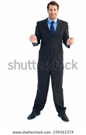 Businessman holding something with his hands on white background - stock photo