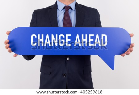 Businessman holding speech bubble with a word CHANGE AHEAD - stock photo