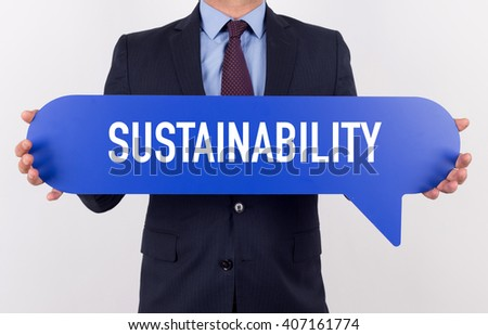 Businessman holding speech bubble with a word SUSTAINABILITY - stock photo