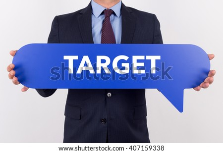 Businessman holding speech bubble with a word TARGET - stock photo