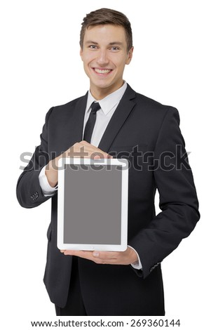 Businessman holding tablet in hands isolated - stock photo