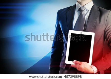 Businessman holding tablet to make success in business