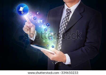 Businessman holding tablet with pressing delivery icon button. internet and networking concept