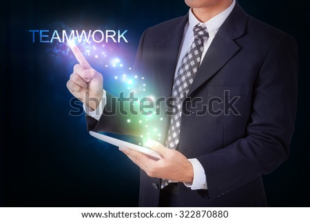 Businessman holding tablet with pressing start. internet and networking concept - stock photo