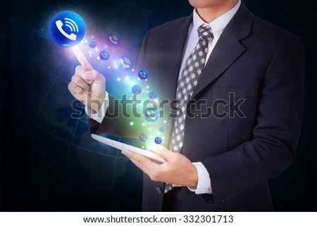 Businessman holding tablet with pressing telephone sign icon button. internet and networking concept