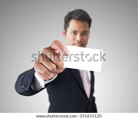 Businessman holding the card on hands.