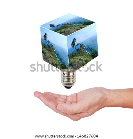 Businessman holding the Cubic with nature tree growing inside isolated in white. - stock photo