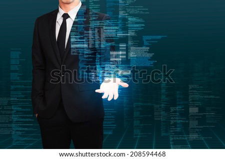 businessman holding the floating program code,concept of information technology - stock photo