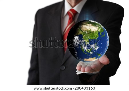 Businessman holding the globe - Asian Continent (Elements of this image furnished by NASA)
