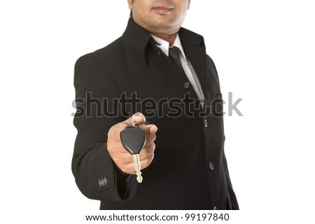 Businessman holding the key on a white background - stock photo