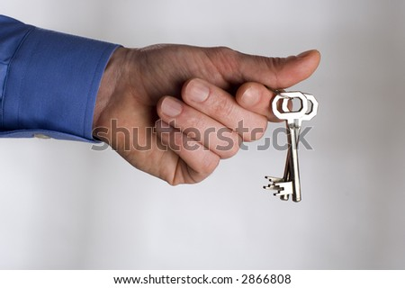 businessman holding the keys close up shoot - stock photo