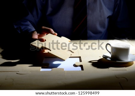 Businessman holding the last piece