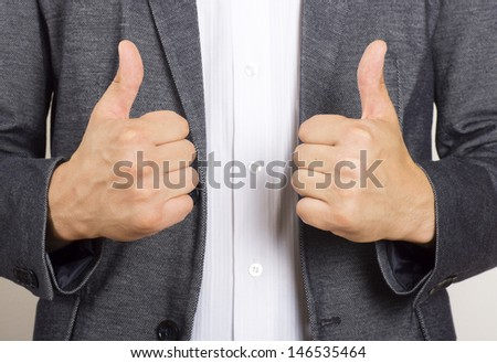 businessman holding two thumbs up - stock photo