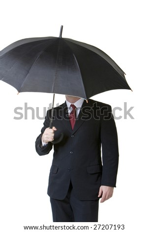 Businessman holding umbrella
