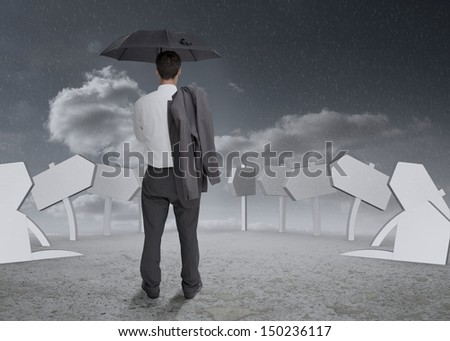 Businessman holding umbrella and jacket and thinking about his future