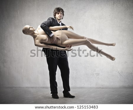 Businessman holding under the arm