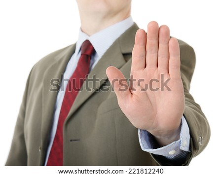 businessman holding up stop palm hand gesture - stock photo