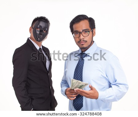 businessman holding US bank note.Getting money by corruption - stock photo