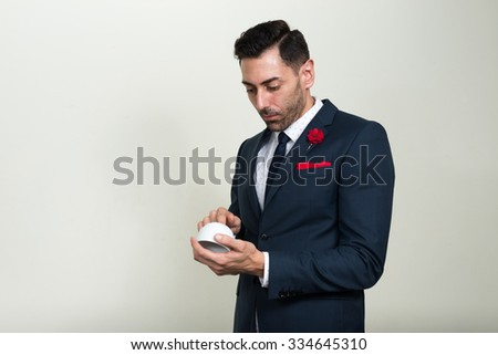 Businessman holding using coffee cup as mobile phone