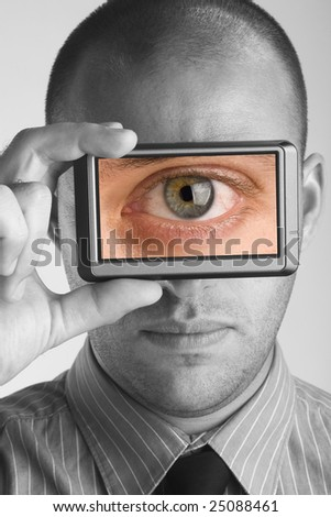Businessman holding visual screen monitor showing picture of an eye