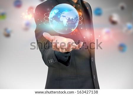 businessman holding world - stock photo