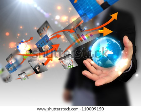 businessman holding world, connected - stock photo