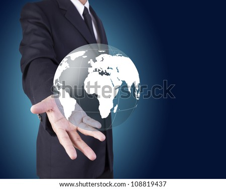 Businessman holding world graphic