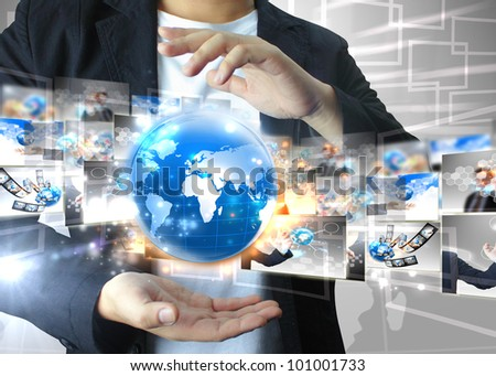 Businessman holding world .Technology concept