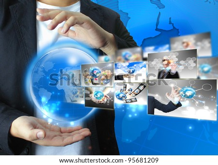Businessman holding world .Technology concept - stock photo
