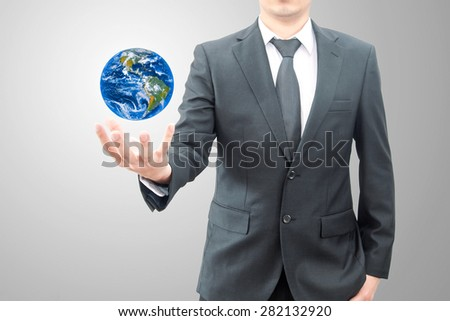Businessman holds Earth in a hand , Elements of this image are provided courtesy of NASA - stock photo