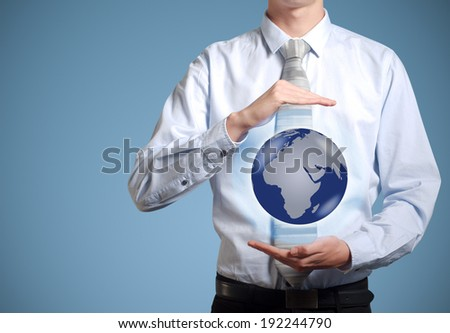 Businessman holds or holding world earth in the palm of hand - stock photo