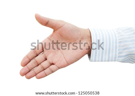 Businessman holds out his hand for a handshake - stock photo