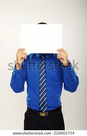 Businessman holds paper front of his face, you can write some text on the paper