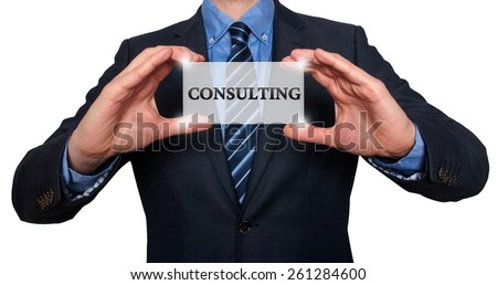 Businessman holds white card with Consulting sign, White - Stock Photo - stock photo