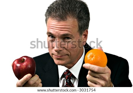 Businessman impressing upon his group the fallacy of using unlike measures. - stock photo