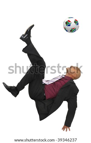 Businessman in a acrobatic pose with a soccer ball isolated in white - stock photo