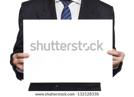 Businessman in a black suit holding a blank paper in the hands isolated on white background horisontal - stock photo