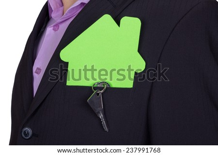 Businessman in a business suit with a model of a private house in the pocket. House and keys, the idea of ??security. Real estate transactions. The real estate agent. The concept of private property. - stock photo