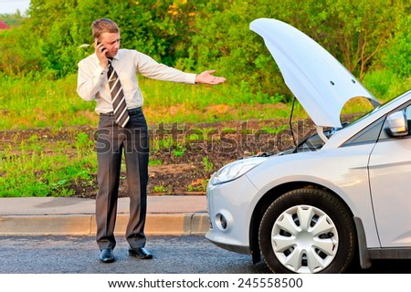 businessman in a car crash - stock photo