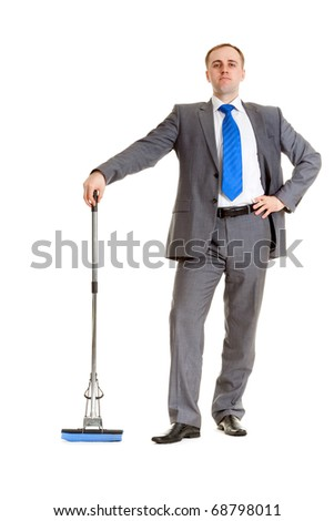 Businessman in a gray suit with a blue mop - stock photo