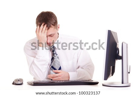 businessman in a shirt sitting at a computer on a white background