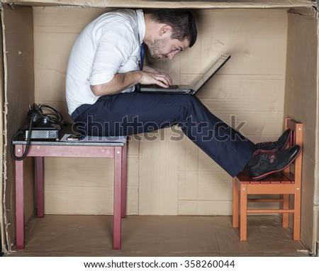 businessman in a strange position - stock photo